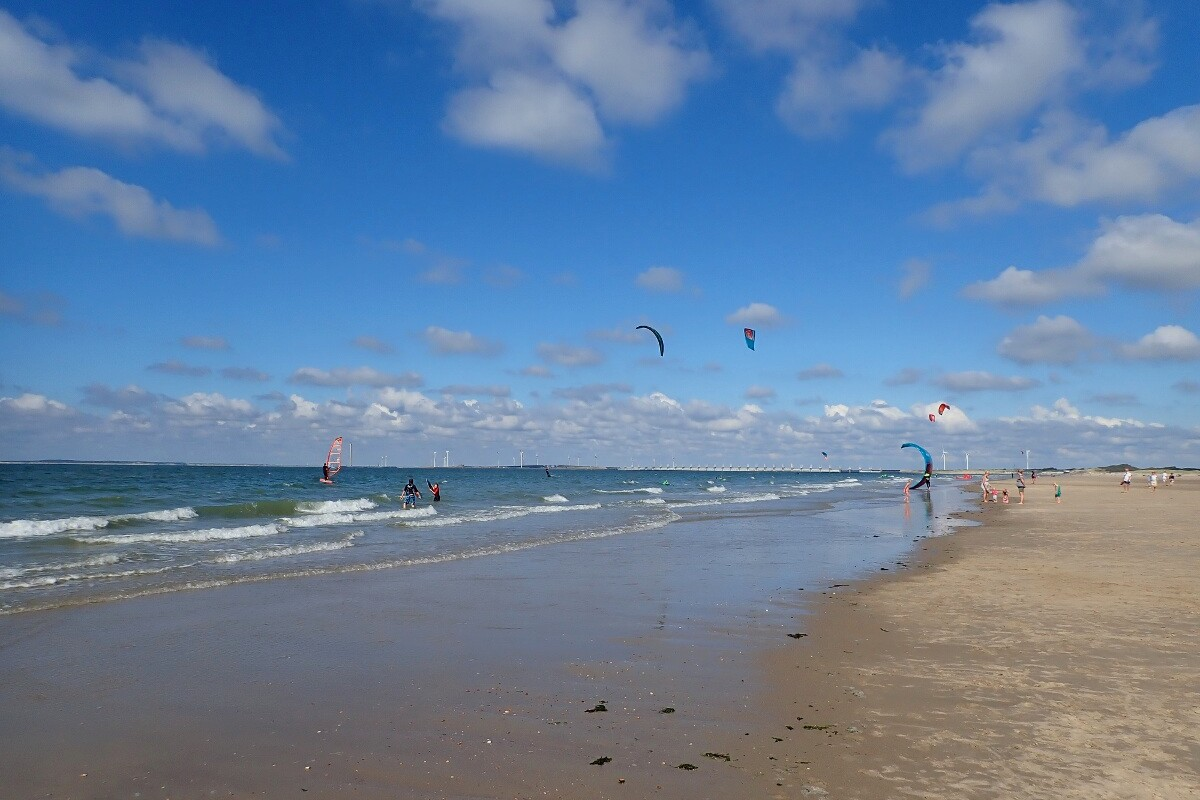 beach with kite surfers