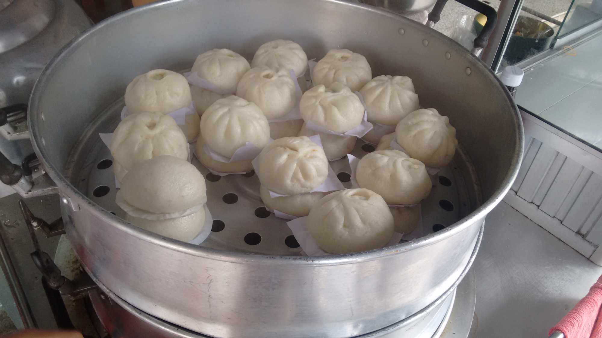 Baozi or bao, filled with meat or taro